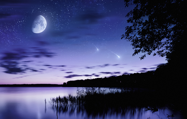 Moon and shooting stars over lake shortly after sundown